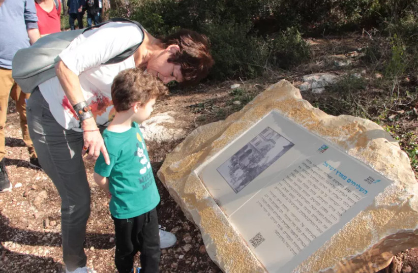A mother and son look at an information board on the Bricha Trail, a project that is being launched by JNF South Africa and KKL-JNF on Tu Bishvat on Wednesday. (photo credit: YOAV DEVIR KKL-JNF)