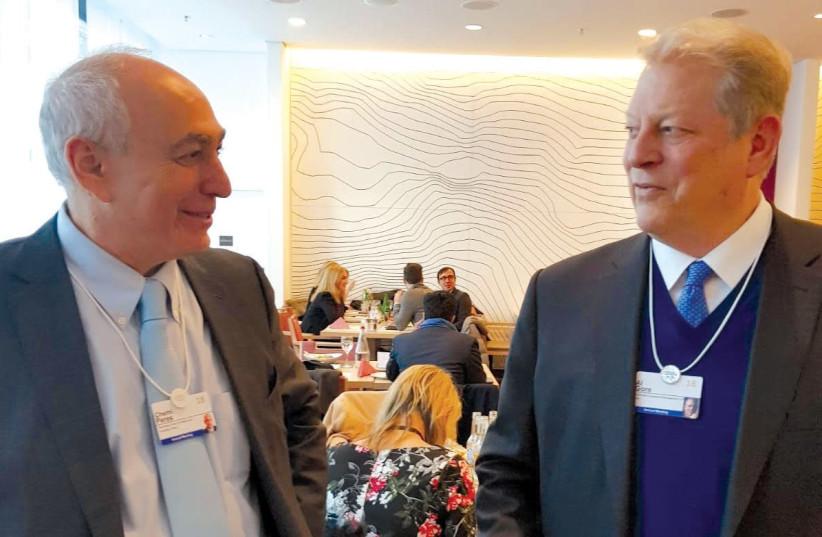 Chemi Peres and Al Gore (photo credit: Courtesy)