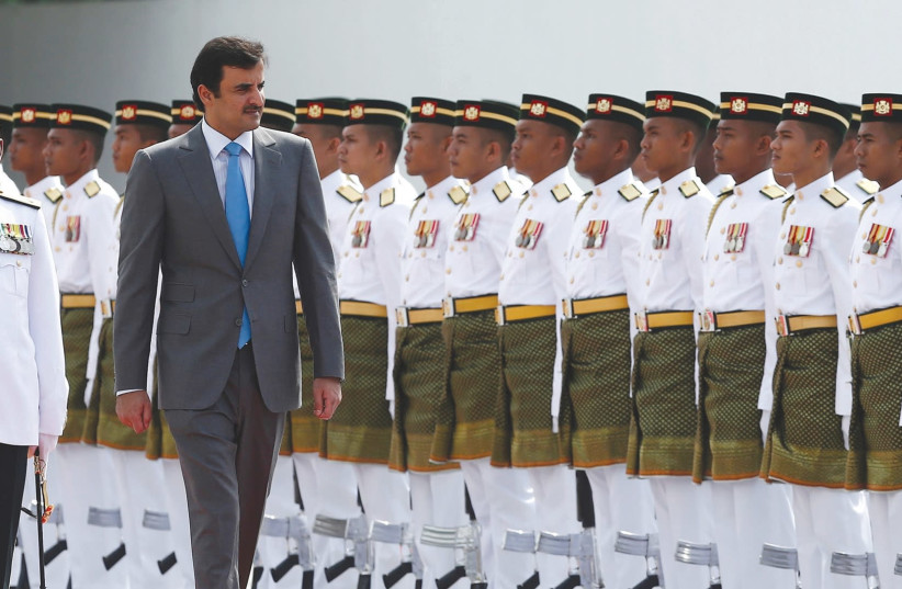 EMIR Sheikh Tamim bin Hamad al-Thani inspects an honor guard during a state welcome ceremony at the Parliament House in Kuala Lumpur, Malaysia. (photo credit: REUTERS)