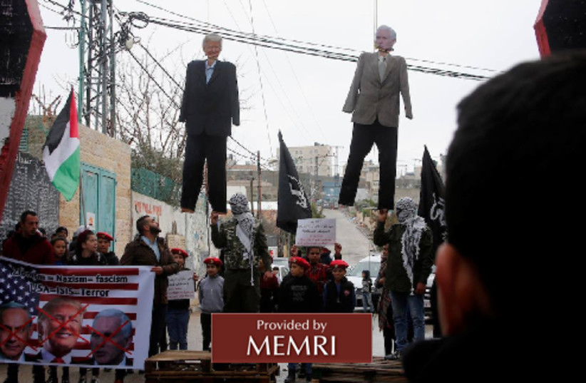 Palestinians hang effigies of US President Donald Trump and US Vice Presdient Mike Pence on January 27, 2018. (photo credit: MEMRI)