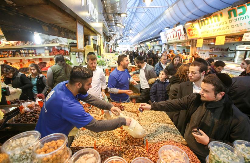 Tu Bishvat shopping at Jerusalem's Mahane Yehuda market (photo credit: MARC ISRAEL SELLEM/THE JERUSALEM POST)
