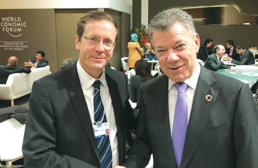 OPPOSITION LEADER Isaac Herzog with Colombian President Juan Manuel Santos in Davos. (photo credit: Courtesy)