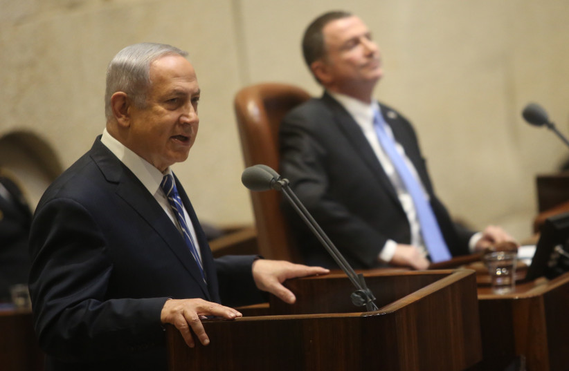 Benjamin Netanyahu speaks to the Knesset, 31 January, 2018 (photo credit: MARC ISRAEL SELLEM)