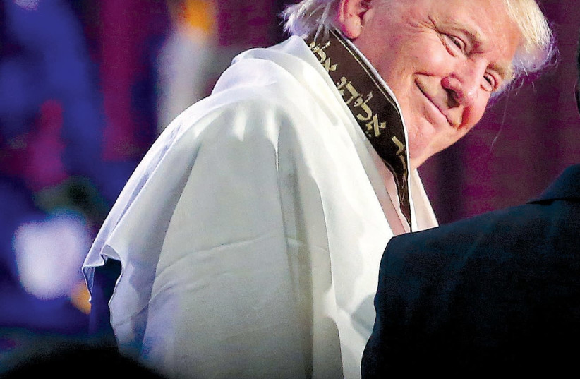 Donald Trump wears a tallit during a church service with Bishop Wayne T. Jackson at the Great Faith Ministries International in downtown Detroit (photo credit: CARLO ALLEGRI/REUTERS)