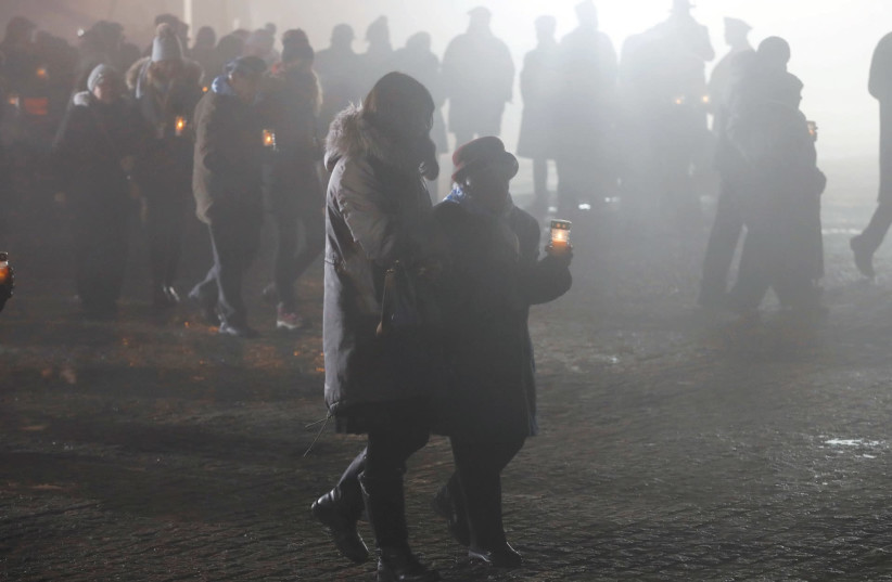 SURVIVORS AND guests light candles at the former Nazi concentration and extermination camp Auschwitz II-Birkenau in Poland last Saturday, on International Holocaust Remembrance Day. (photo credit: KACPER PEMPEL/REUTERS)