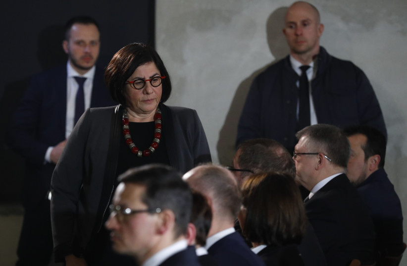 """Ambassador of Israel to Poland Anna Azari attends a commemoration event in the so-called """"Sauna"""" building at the former Nazi German concentration and extermination camp Auschwitz II-Birkenau, January 27, 2018 (photo credit: REUTERS/KACPER PEMPEL)"""