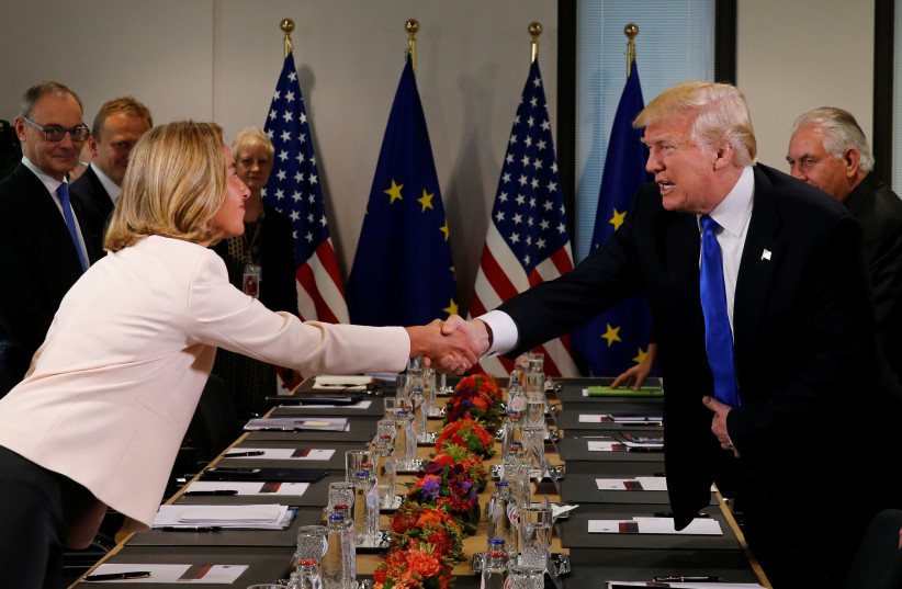 U.S. President Donald Trump (R) shakes hands with European Union foreign policy chief Federica Mogherini before their meeting at the European Union headquarters in Brussels, Belgium, May 25, 2017. (photo credit: REUTERS)