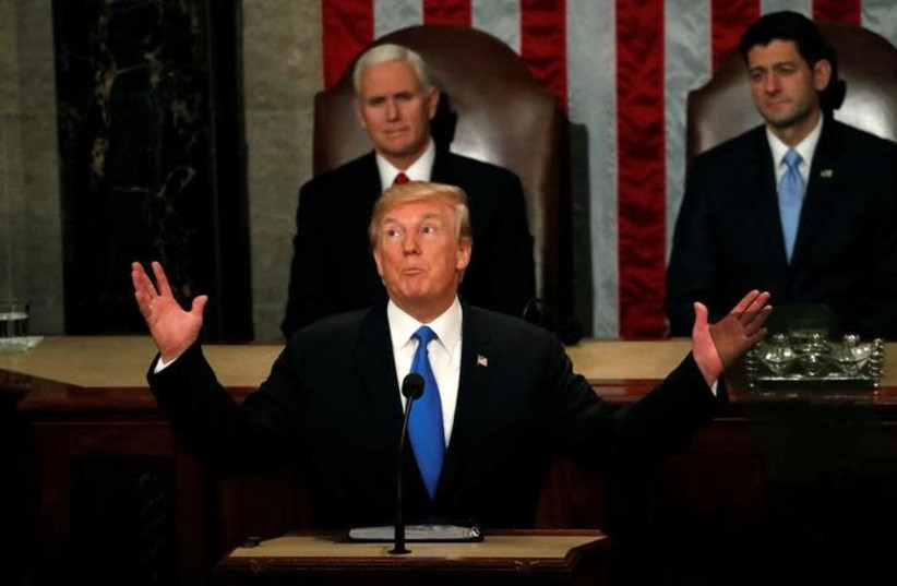 US President Donald Trump gestures as he delivers his State of the Union address to a joint session of the US Congress on Capitol Hill in Washington, US January 30, 2018 (photo credit: REUTERS/LEAH MILLIS)