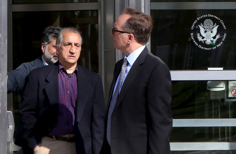 Ahmad Sheikhzadeh (C), a consultant to the Iranian mission to the United Nation, leaves Brooklyn Federal Court in New York. (photo credit: REUTERS)