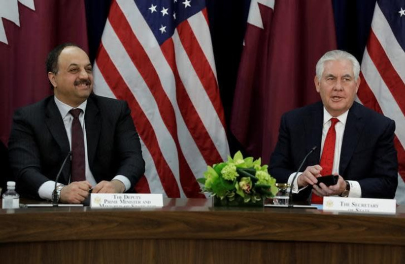 US Secretary of State Rex Tillerson (R) speaks next to Qatari Defense Minister Khalid bin Muhammad al-Attiyah at the opening session of the inaugural US-Qatar Strategic Dialogue at the State Department in Washington, US, January 30, 2018 (photo credit: REUTERS/YURI GRIPAS)