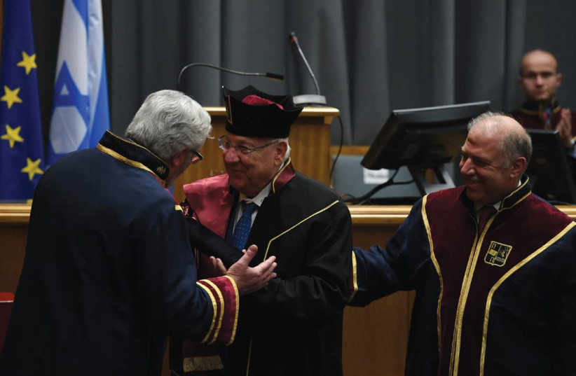 PRESIDENT REUVEN RIVLIN (center) is congratulated following the conferral of his honorary doctorate by the University of Piraeus. (photo credit: HAIM ZACH/GPO)
