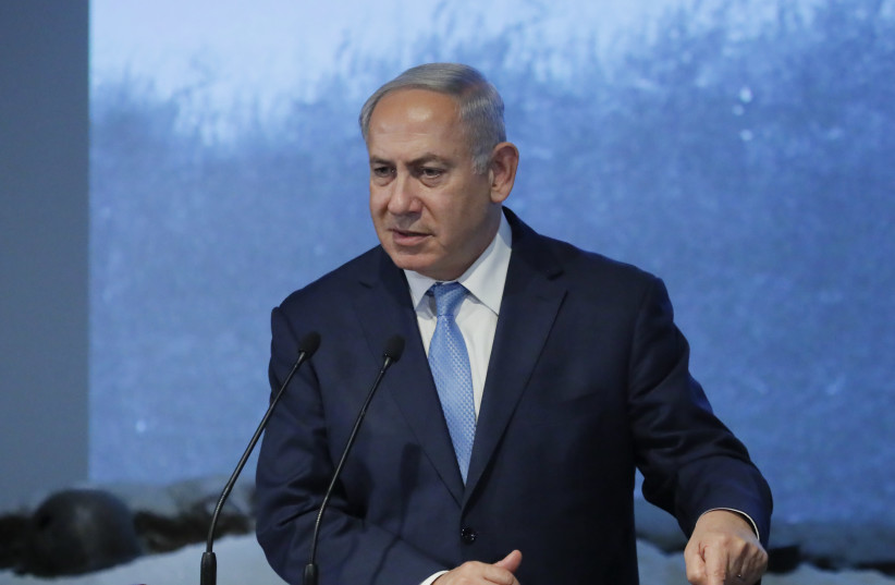 Benjamin Netanyahu delivers a speech during an event marking International Holocaust Remembrance Day at the Jewish Museum and Tolerance Centre in Moscow, Russia January 29, 2018.  (photo credit: REUTERS/MAXIM SHEMETOV)