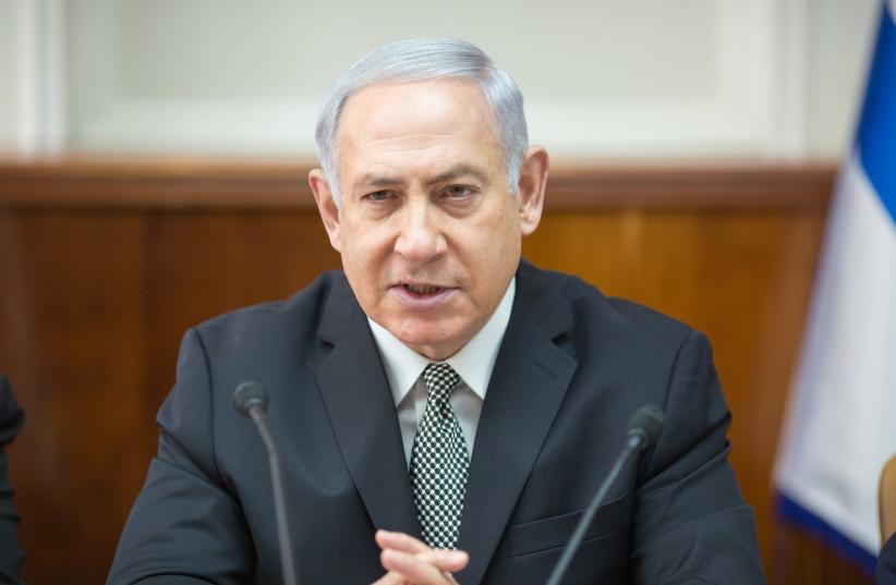 Prime Minister Benjamin Netanyahu at a weekly cabinet meeting on February 4, 2018. (photo credit: EMIL SALMAN/POOL)