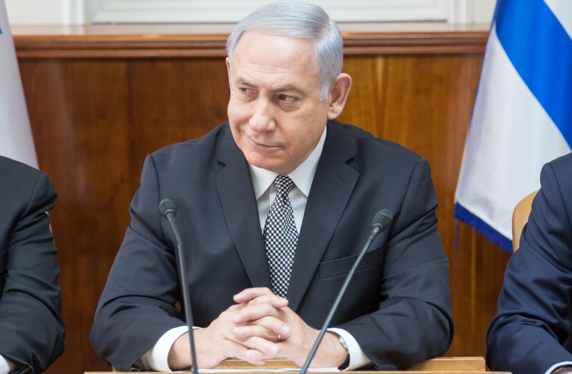 Prime Minister Benjamin Netanyahu at a weekly cabinet meeting on February 4, 2018. (photo credit: EMIL SALMAN/POOL)