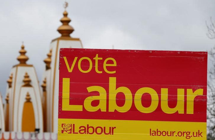 A vote Labour sign is seen near the Gita Bhavan Hindu Temple in Whalley Range, Manchester, Britain April 20, 2017 (photo credit: REUTERS/ANDREW YATES)