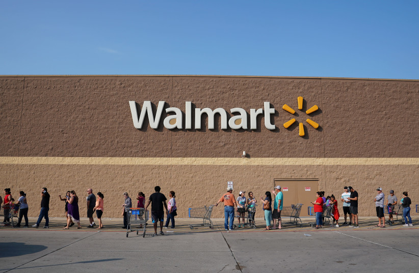 People line up outside a Walmart store (photo credit: CARLO ALLEGRI/REUTERS)