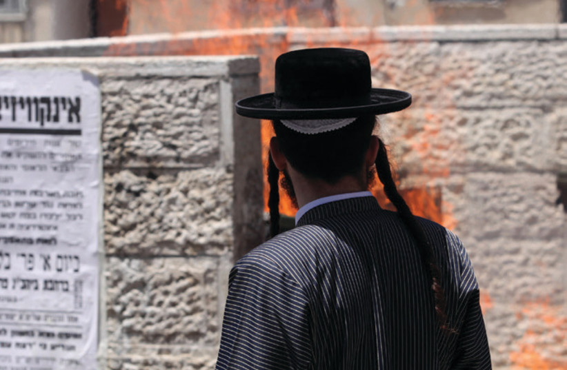 A young Haredi man outside the IDF enlistment office in Jerusalem (photo credit: MARC ISRAEL SELLEM)