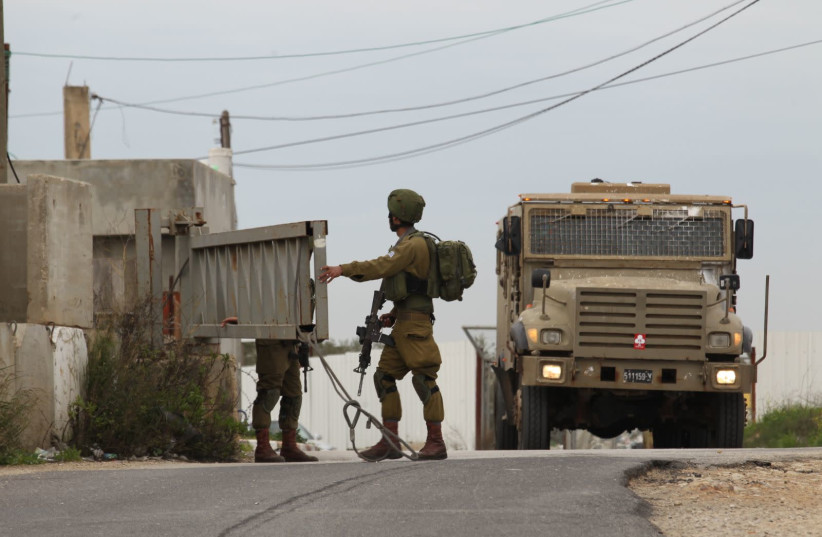 IDF soldiers searching the area after West Bank stabbing attack (photo credit: HILLEL MAEIR/TPS)