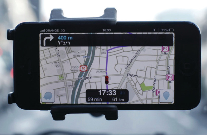 Waze, an Israeli mobile satellite navigation application, has revolutionized driving (photo credit: REUTERS/NIR ELIAS)