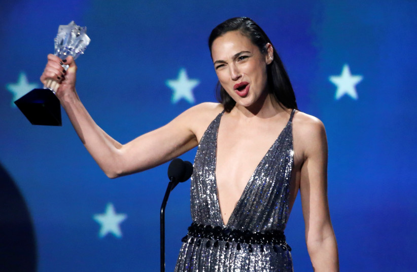 "Actress Gal Gadot receives the 2018 #See Her award at the 23rd Critics' Choice Awards for her performance in ""Wonder Woman."" (photo credit: REUTERS)"