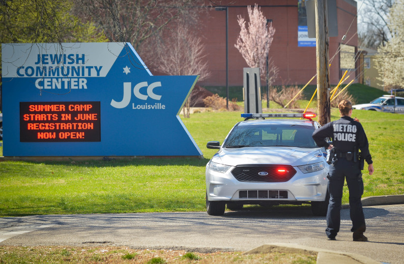 A police officer blocks an entrance as officials respond to a bomb threat at the Jewish Community Center in Louisville, Kentucky. (photo credit: REUTERS)