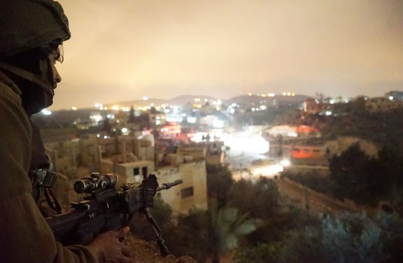 An IDF sniper during a raid the West Bank village of Al-Yamun (photo credit: IDF SPOKESPERSON'S UNIT)