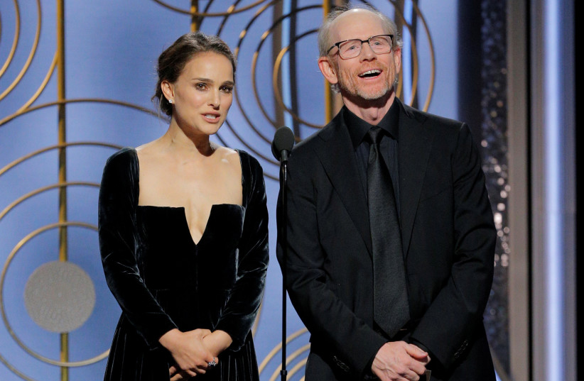 Presenter Natalie Portman and Ron Howard at the 75th Golden Globe Awards in Beverly Hills, California, US January 7, 2018.  (photo credit: HANDOUT/REUTERS)