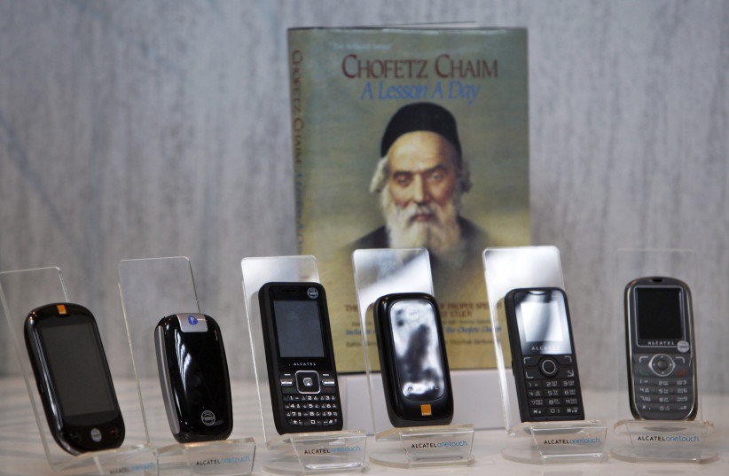 Kosher cellular phones, imported and distributed by Israeli Accel Telecom, are displayed at the company's offices in Tel Aviv (photo credit: NIR ELIAS / REUTERS)