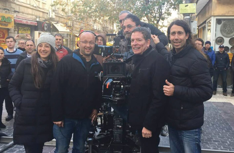 Writer/ Director David Zucker on the set of new Israeli comedy 'Mossad' on Jerusalem's Ben-Yehuda Street, with the film's director Alon Gur Arye (photo credit: Courtesy)