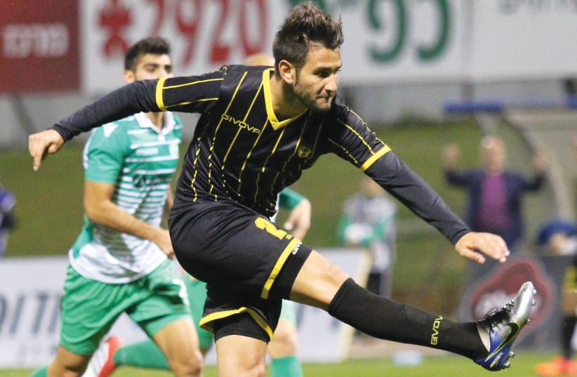Beitar Jerusalem striker Gaetan Varenne fires his team into the lead in a 2-0 victory at Hapoel Kfar Saba in the first leg of the State Cup quarterfinals. (photo credit: ADI AVISHAI)