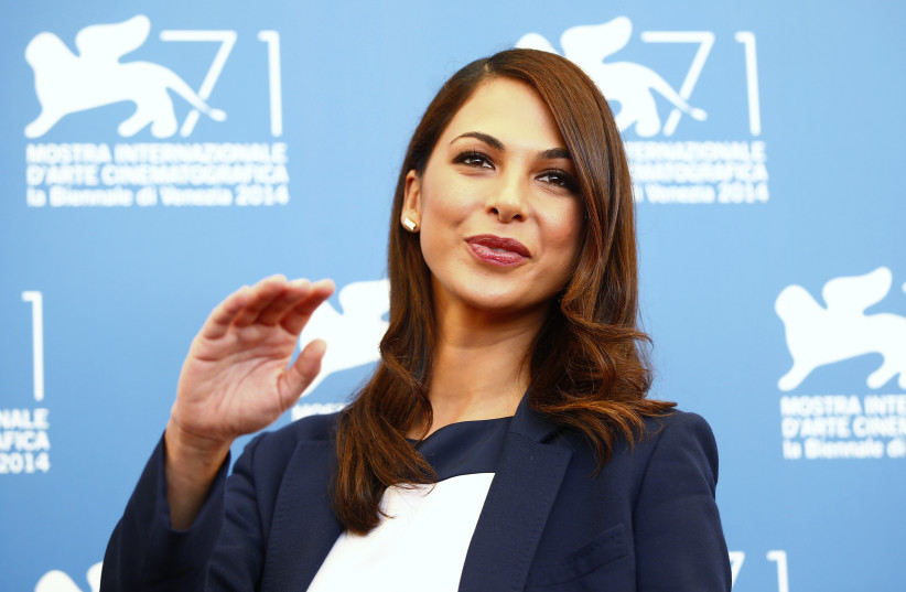 Actress Moran Atias, a member of the jury at the 71st Venice Film Festival, poses during a photo call for the event in Venice August 27, 2014 (photo credit: REUTERS/TONY GENTILE)