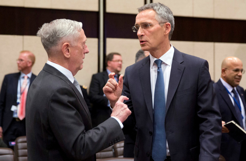 US Secretary for Defense Jim Mattis talks with NATO Secretary General Jens Stoltenberg prior to a meeting on the sidelines of a NATO defence ministers meeting at NATO headquarters in Brussels, Belgium (photo credit: REUTERS/VIRGINIA MAYO/POOL)