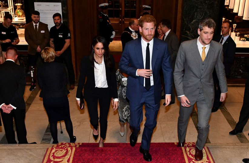 Britain's Prince Harry and his fiancee Meghan Markle arrive to attend the annual Endeavour Fund Awards at Goldsmiths' Hall in London, Britain. (photo credit: REUTERS)