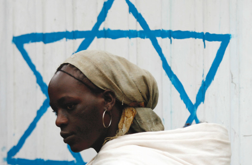 An Ethiopian Jewish woman arrives for the beginning of the Rosh Hashanah services at a synagogue in Addis Ababa. (photo credit: REUTERS)
