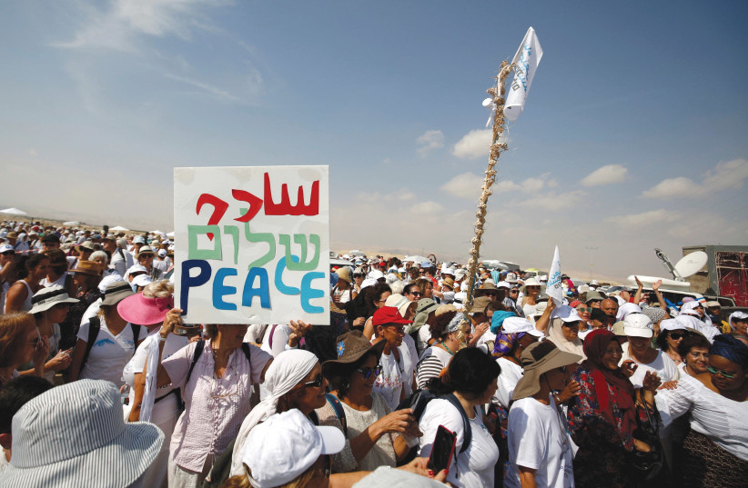 Activists march in support of peace.  (photo credit: REUTERS)