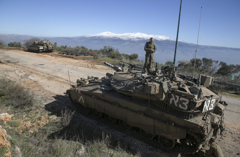 An Israeli soldier stands atop a tank near Israel's border with Lebanon January 21, 2015. (photo credit: REUTERS)