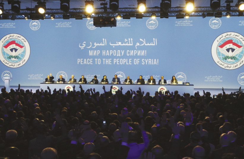 PARTICIPANTS ATTEND a session of the Syrian National Dialogue Conference in the Black Sea resort of Sochi, Russia, last month. (Sergei Karpukhin/Reuters) (photo credit: SERGEI KARPUKHIN/REUTERS)