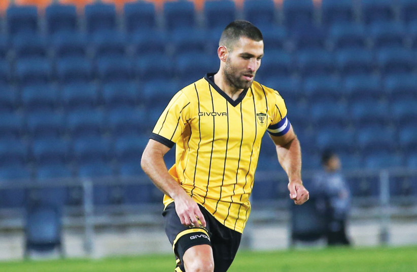 The form of Beitar Jerusalem striker Itay Shechter (above) has been one of the main reasons behind the team's impressive run. Beitar can climb up to first place with a win at Hapoel Ashkelon on Saturday. (photo credit: DANNY MARON)