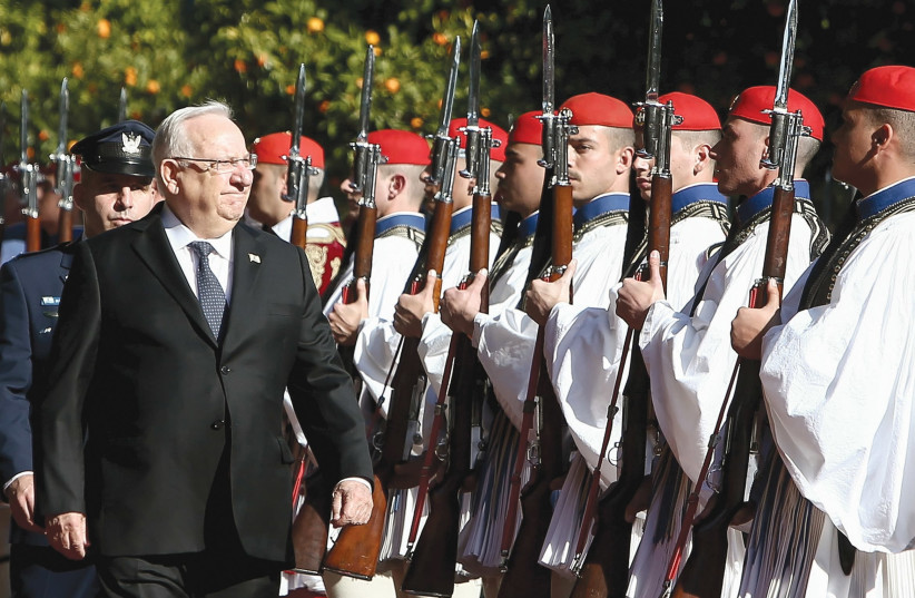 PRESIDENT REUVEN RIVLIN inspects a guard of honour during a welcome ceremony in Athens in January, 2018.. (photo credit: REUTERS)