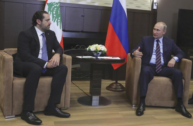 RUSSIAN PRESIDENT Vladimir Putin meets with Lebanese Prime Minister Hariri in Sochi in 2017. (photo credit: REUTERS)