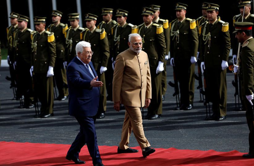 Palestinian Authority President Mahmoud Abbas reviews the honour guard with India's Prime Minister Narendra Modi. (photo credit: REUTERS/MOHAMAD TOROKMAN)