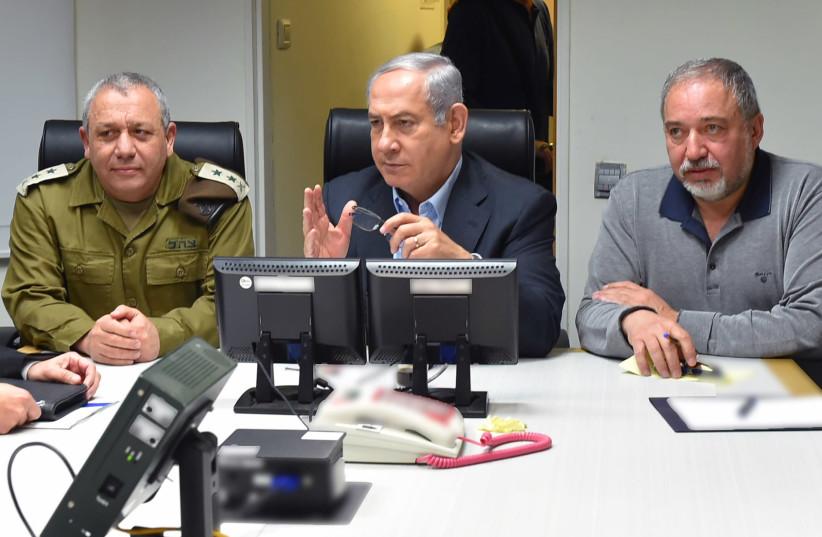 IDF Chief of Staff Gadi Eisenkot, Prime Minister Benjamin Netanyahu and Defense Minister Avigdor Liberman meet to discuss Israeli-Iranian escalation in Syria, February 2018 (photo credit: ARIEL HERMONI / DEFENSE MINISTRY)