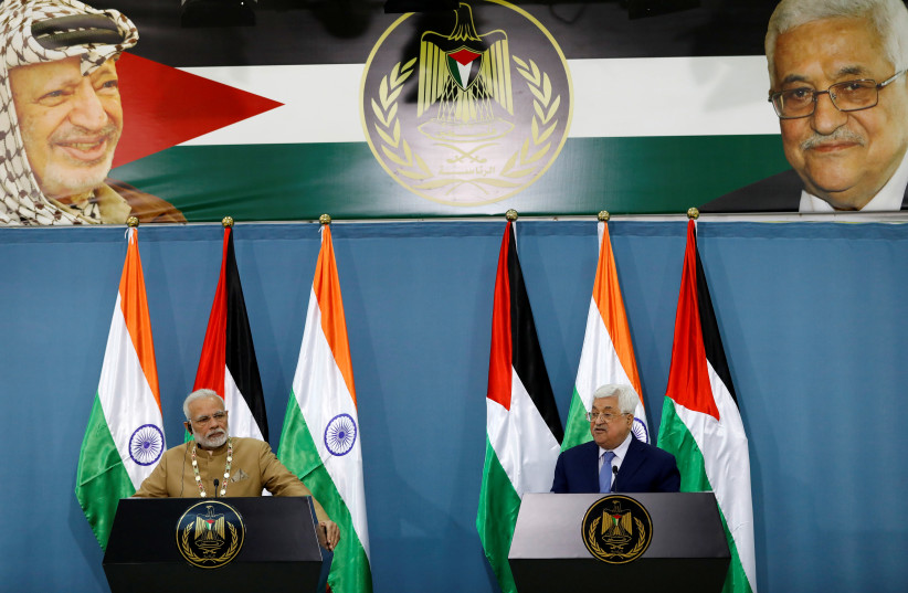 Palestinian President Mahmoud Abbas speaks during an news conference with India's Prime Minister Narendra Modi, in Ramallah (photo credit: REUTERS/MOHAMAD TOROKMAN)