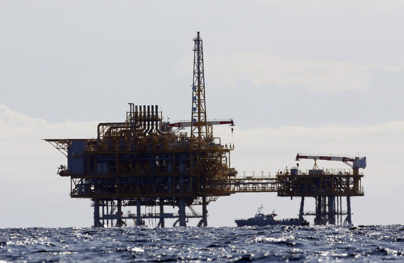 An offshore natural gas rig in the Mediterranean Sea (photo credit: GUSTAV NACARINO / REUTERS)