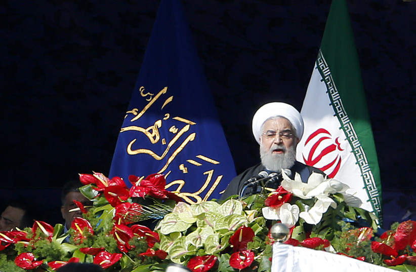 Iranian President Hassan Rouhani delivers a speech at the Azadi Square in the capital Tehran during a ceremony to mark the 39th anniversary of the Islamic revolution (photo credit: ATTA KENARE / AFP)