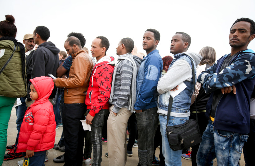 African asylum seekers line up to apply for a visa in Bnei Brak, Israel (photo credit: MARC ISRAEL SELLEM/THE JERUSALEM POST)