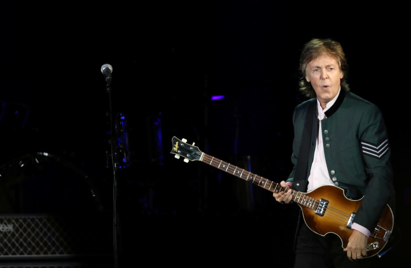 """British musician Paul McCartney performs during the """"One on One"""" tour concert in Porto Alegre, Brazil (photo credit: REUTERS)"""