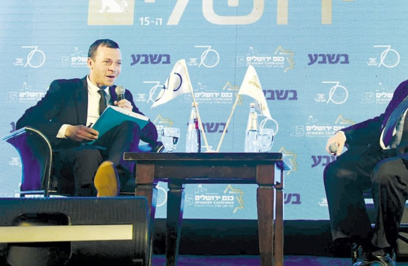 President Reuven Rivlin (right) is interviewed by TV journalist Amit Segal yesterday at the 15th annual Jerusalem Conference of the Besheva Group (photo credit: MARK NEIMAN)