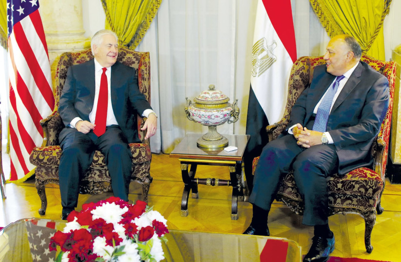 US Secretary of State Rex Tillerson (left) meets with Egyptian Foreign Minister Sameh Shoukry (Kacper Pempel/Reuters) in Cairo February 12, 2018 (photo credit: KHALED ELFIQI/REUTERS)