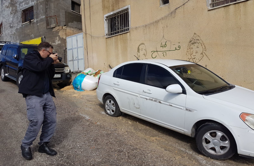 A car in Jit that was allegedly vandalized by settlers. (photo credit: ISRAEL POLICE)